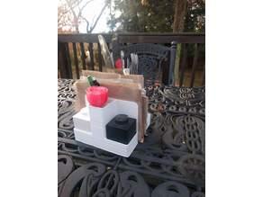 Napkin/condiment holder