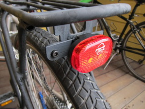 Bike light to rack adapter plate