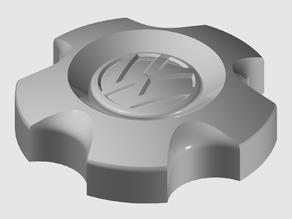 Wheel cap and new Volkswagen (VW) logo