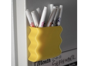 Wobbly refridgerator dry erase pen holder