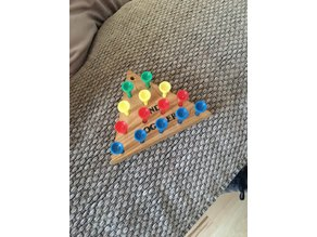 Thirteen_Peg_Puzzle_Board_with_Pegs