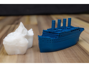 Small compressed Titanic and scale example of the iceberg