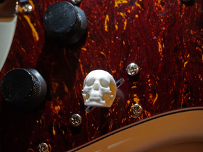 Electric guitar skull tone switch