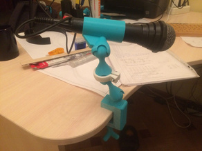 microphone holder on a hinge