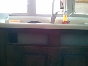 Sink cabinet panel holder.