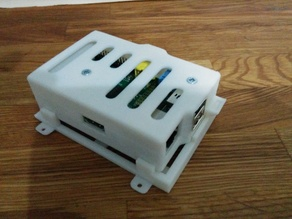 Raspberry Pi case with click-on wall plate and slot for GPIO cable