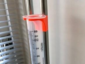 Feeding tube syringe holder