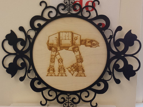 Laser etched ATAT walker in a laser cut frame