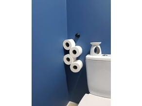 Floating toilet roll holder