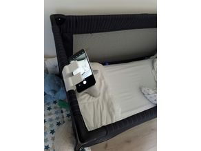 Phone dock for baby's foldable bed