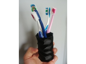Twisted cup for penscils or toothbrushes