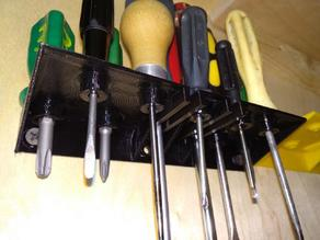 Screwdrivers mount to the wall