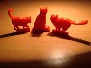 red cats on the table