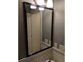Stick-on frame for bathroom mirror
