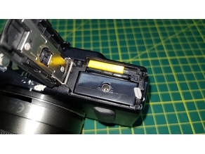 Canon EOS-m Battery switch defeat