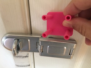 Padlocked sliding door latch mount