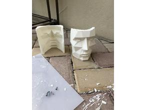 low poly face as negative mold and pen holder