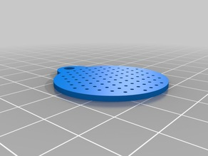 Keychain with perforation for training vision.