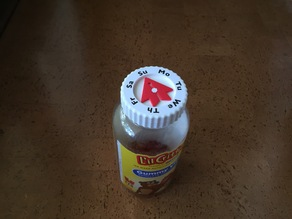 Vitamin bottle cap with day arrow