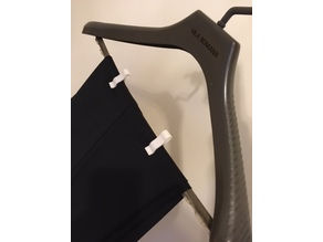 Pant-clip for coat hanger