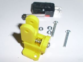 Thumb adjustable z-axis microswitch