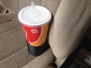 Passenger seat cup holder