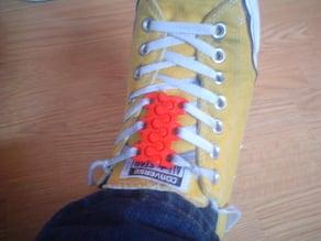 Shoelace clip