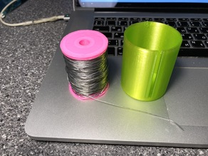 Spool for a soldering wire with container