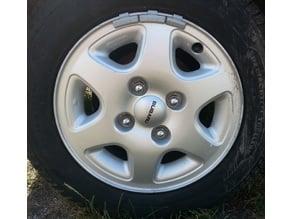 Subaru Justy alloy rim center cap