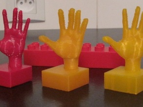 Hand on duplo-compatible block