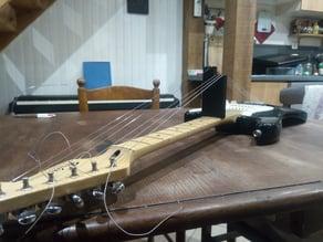 Chock for guitar string changes (cale pour changement cordes de guitare)