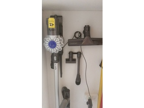Dyson universal head hanger and tool mount.
