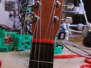 Nut for acoustic guitars
