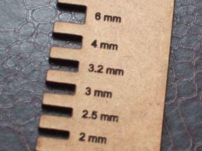 Sheet thickness gauge