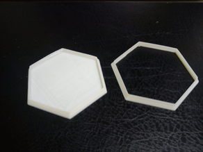 Hexagonal game tile bases and cutters