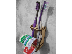 Holder for toothbrushes and toothpaste