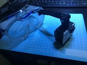 Camera arm for goggle lens