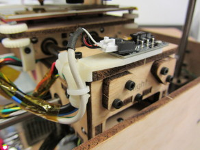 X-axis strain relief and build platform wire guide