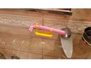Stand for women´s shaving blade