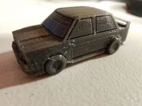 Low poly rally car with print in place wheels