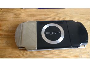 Playstation portable battery cover