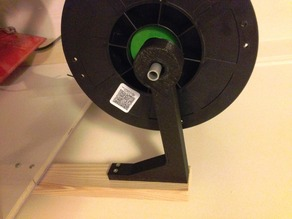 Spool support arm