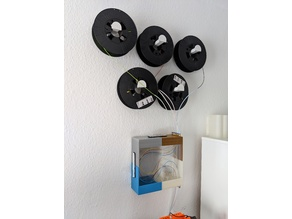 Wall mounted spool holder