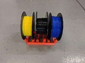Three spool filament roller