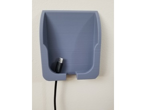 Wall mounted cell phone cradle