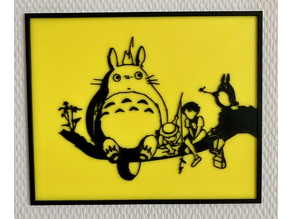 Totoro sitting on a tree