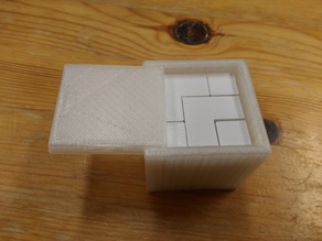Puzzle cube in a box