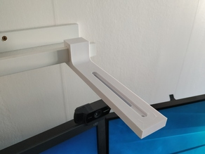 Frame ledge universal holding arm