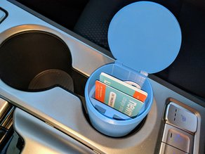 Electric vehicle charging cards holder for cupholder