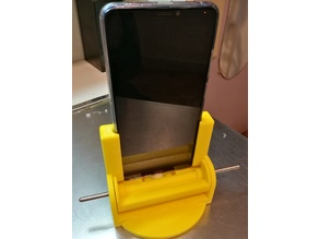 Customizable phone charging stand with ejector